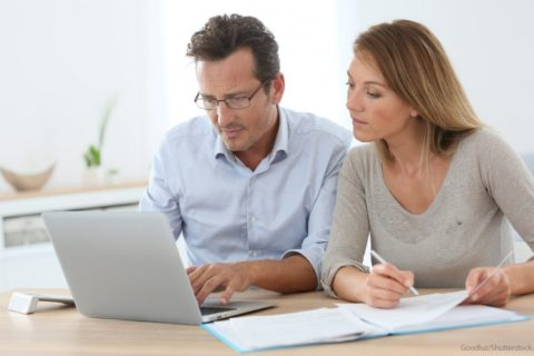 couple discussing about tax on laptop