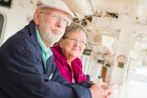 grandparents standing in a balcony
